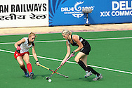 during the pool B women's hockey match of the The Commonwealth Games between New Zealand and Wales held at the Stadium in New Delhi, India on the  October 2010..Photo by:  Ron Gaunt/SPORTZPICS/PHOTOSPORT