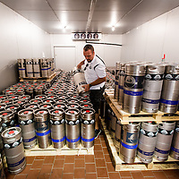 MIAMI, FLORIDA -- July 11, 2015 -- Gustavo Chacon grabs a keg for a beer event in a cooler at the new Biscayne Bay Brewing Company in Miami, Florida.  (PHOTO / CHIP LITHERLAND)