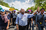 "09 MAY 2014 - BANGKOK, THAILAND:  SUTHEP THAUGSUBAN leads a march of anti-government protestors to Government House in the Dusit neighborhood of Bangkok. Thousands of Thai anti-government protestors took to the streets of Bangkok Friday to start their ""final push"" to bring the popularly elected of government of Yingluck Shinawatra. Yingluck has already been forced out by a recent court ruling that forced her to resign and she is facing indictment by the National Anti Corruption Commission of Thailand for alleged improprieties related to a government rice price support scheme. The protestors Friday were marching to demand that she not be allowed to return to politics. The courts have not banned her party, Pheu Thai, which has formed an interim caretaker government to govern until elections expected in July, 2014. Suthep Thaugsuban, secretary-general of the People's Democratic Reform Committee (PDRC),  said the president of the Supreme Court and the new senate speaker, who would be selected Friday, should set up an ""interim people's government and legislative assembly."" He went onto say that if they didn't, he would.    PHOTO BY JACK KURTZ"