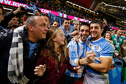Suppoerters celebrate with Argentina replacement Tomas Cubelli after Argentina win the match - Mandatory byline: Rogan Thomson/JMP - 07966 386802 - 18/10/2015 - RUGBY UNION - Millennium Stadium - Cardiff, Wales - Ireland v Argentina - Rugby World Cup 2015 Quarter Finals.