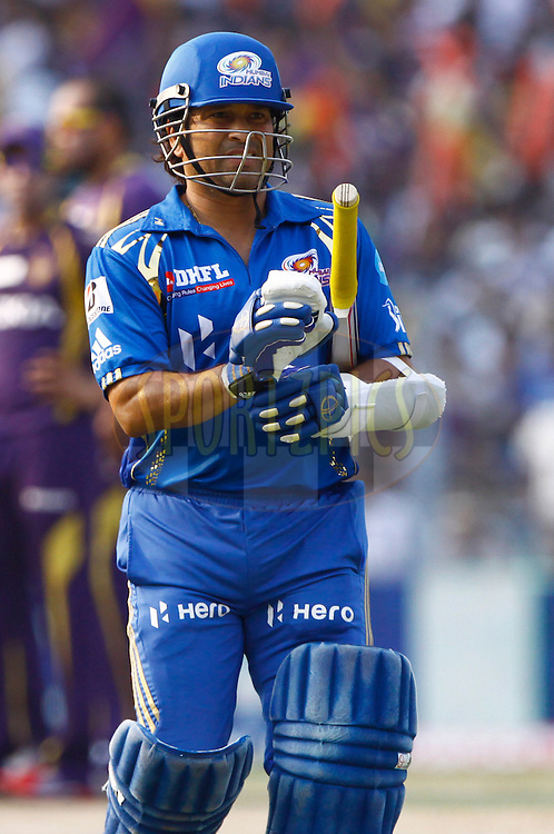 Mumbai Indian player Sachin Tendulkar walks back after getting outduring match 58 of the the Indian Premier League ( IPL) 2012  between The Kolkata Knight Riders and The Mumbai Indians held at the Eden Gardens Stadium in Kolkata on the 12th May 2012..Photo by Pankaj Nangia/IPL/SPORTZPICS
