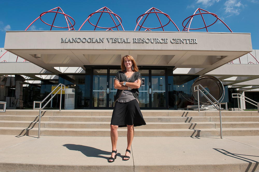 Michelle Terron of the KRESGE ARTS IN DETROIT foundation in front of the Manoogian Visual Recource Center in Detroit, Michigan, where her office is located.<br /> <br /> Art in Detroit 2013<br /> &copy; Stefan Falke<br /> www.stefanfalke.com