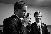 Waiting for Sunday church services to begin, Elder Bradley Merrill, left, smells a new bible next to his partner Elder Todd Balls, on Sunday morning, May 25, 2008, in The Plains, Ohio.