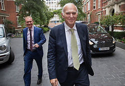 © Licensed to London News Pictures. 20/07/2017. London, UK. Vince Cable arrives at his Liberal Democrat party leadership announcement event followed by previous party leader Tim Farron (L). Tim Farron stepped down after the general election.  Photo credit: Peter Macdiarmid/LNP