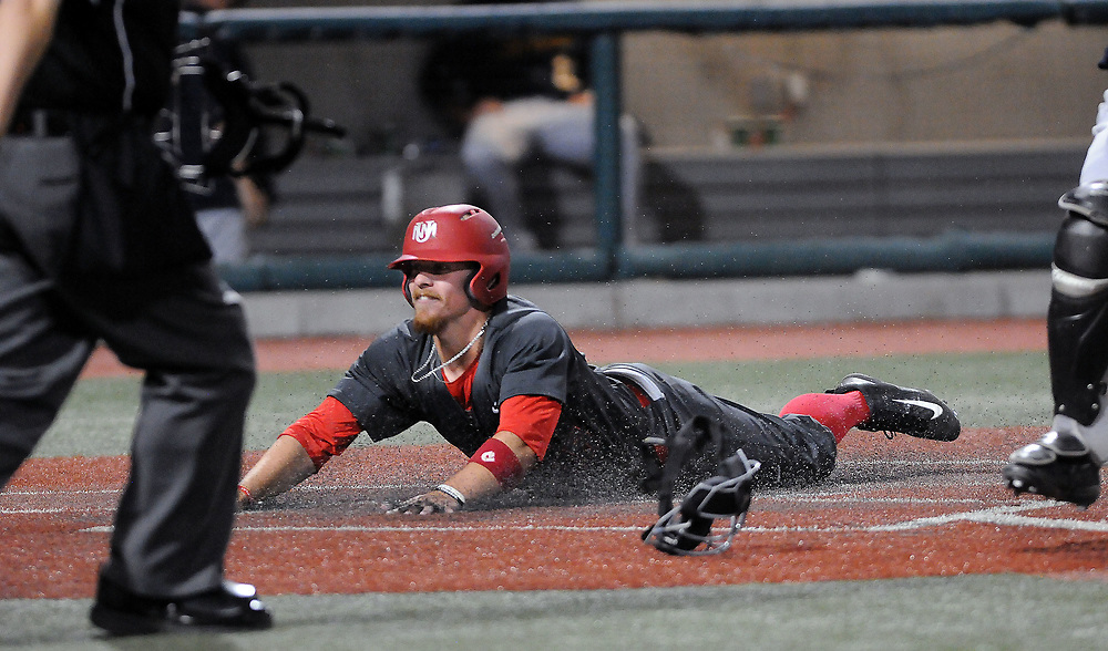 jt052517k/sports/jim thompson/ UNM's #115 Jared Mang slides head first across the plate for the score in their game against Nevada. Thursday May. 25, 2017. (Jim Thompson/Albuquerque Journal)