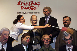Sothebys to sell cast of satirical TV show Spitting Image. Photo shows Mady Delucia from Sothebys cleans the dust off of some of the old politicians, July 7, 2000. Photo by Andrew Parsons / i-images...spain out