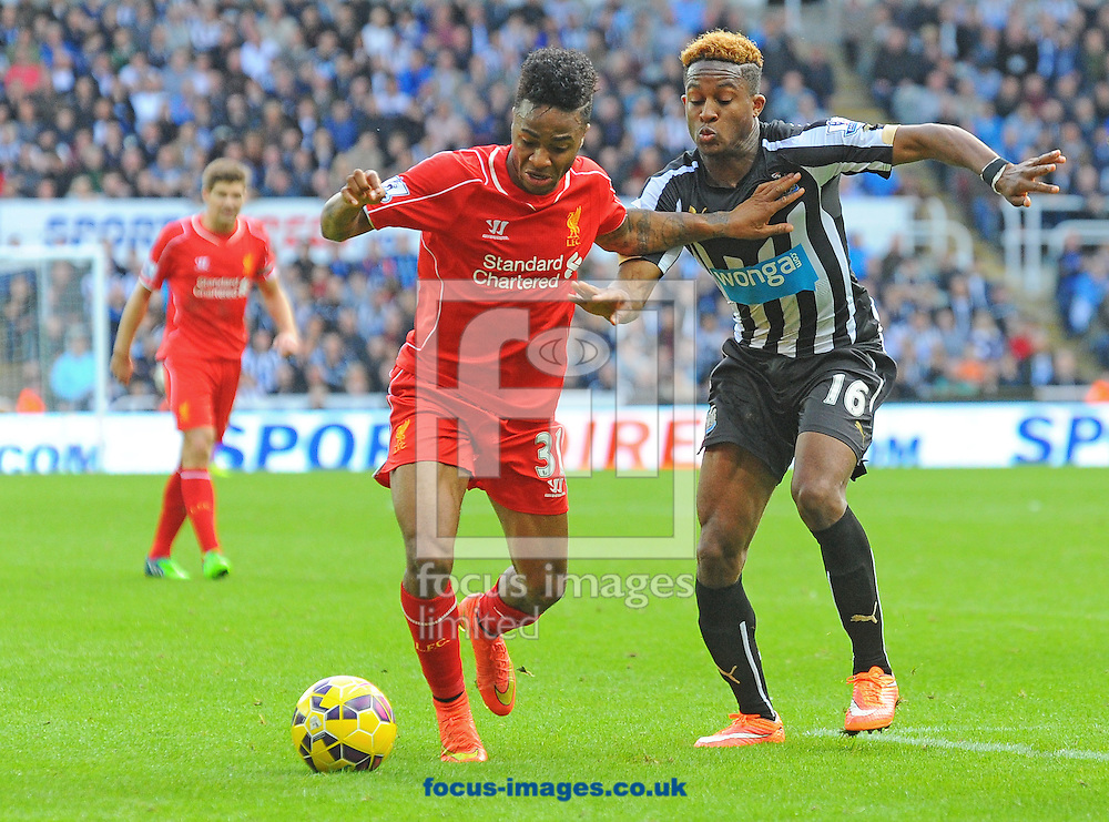 Raheem Sterling of Liverpool (second right) battles with Rolando Aarons of Newcastle United during the Barclays Premier League match at St. James's Park, Newcastle<br /> Picture by Greg Kwasnik/Focus Images Ltd +44 7902 021456<br /> 01/11/2014