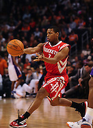Jan. 6 2010; Phoenix, AZ, USA; Houston Rockets guard Kyle Lowry (7) makes a pass against the Phoenix Suns at the US Airways Center.  Phoenix Suns defeated the Houston Rockets 118-110. Mandatory Credit: Jennifer Stewart-US PRESSWIRE