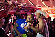 "DALLAS, TX - MARCH 13:  Donald ""Cowboy"" Cerrone takes a photo with a fan during the UFC 185 weigh-ins at the Kay Bailey Hutchison Convention Center on March 13, 2015 in Dallas, Texas. (Photo by Cooper Neill/Zuffa LLC/Zuffa LLC via Getty Images) *** Local Caption *** Donald Cerrone"