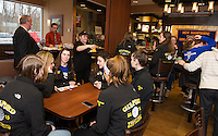 McDonald's Brand Ambassador Larry Johnston, Michael Lepene and Lynn Case serve breakfast to the Gilford High School Volleyball team to celebration their 2015 state championship on Saturday morning.  (Karen Bobotas/for the Laconia Daily Sun)