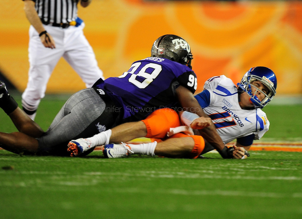 Jan. 4 2010; Glendale, AZ, USA; TCU Horned Frogs defensive end (98) Jerry Hughes tackles Boise State Broncos quarterback (11) Kellen Moore in the 2010 Fiesta Bowl at University of Phoenix Stadium.  Mandatory Credit: Jennifer Stewart-US PRESSWIRE