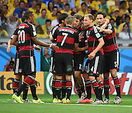 Thomas Muller (centre) of Germany celebrates scoring their first goal during the 2014 FIFA World Cup match at Mineir&atilde;o, Belo Horizonte<br /> Picture by Stefano Gnech/Focus Images Ltd +39 333 1641678<br /> 08/07/2014