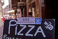 Roma, 22 Luglio 2015<br /> Un ristorante vicino piazza Navona, pizza, aria condizionata, e Wi-Fi free. Continua l'ondata di caldo con temperature che superano i 40 gradi.<br /> Rome, July 22, 2015<br /> A restaurant near Piazza Navona, pizza, air conditioned and Wi-Fi free. Continue the heat wave with temperatures exceeding 40 degrees