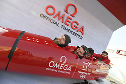 February 8, 2018 - Pyeongchang, CO, South Korea - German employees of Omega clown around Thursday, February 8, 2018 in a static display of a bobsled in Gangneung Olympic Park. The Pyeongchang Winter Games get underway Friday in S. Korea.  Photo by Mark Reis, ZUMA Press/The Gazette (Credit Image: © Mark Reis via ZUMA Wire)