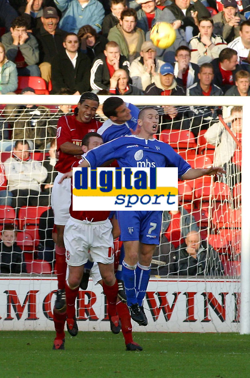 Photo: Dave Linney.<br />Walsall v Gillingham. Coca Cola League 1. 12/11/2005.Chris Westwood(Walsall) rises to the challenge against Andrew Crofts(Gills 7)