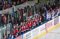 KELOWNA, CANADA - NOVEMBER 7:  The Kelowna Rockets stand on the bench during the national anthem against the Spokane Chiefs on November 7, 2014 at Prospera Place in Kelowna, British Columbia, Canada.  (Photo by Marissa Baecker/Shoot the Breeze)  *** Local Caption *** bench;