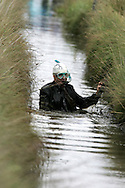PIC BY ANDREW ORCHARD.THE SPMK WORLD BOG SNORKELLING CHAMPIONSHIPS 2006 HELD AT THE WAEN RHYDD PEAT BOG IN LLANWRTYD WELLS, POWYS ON BANK HOLIDAY MONDAY 28TH AUGUST 2006..MAN WEARING A BUSINESS SUIT.