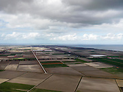 Nederland, Noord-Holland, Gemeente Wieringermeer, 16-04-2012. Middendeel Wieringermeer, ter hoogte van de Zeugweg. Wadenzee en Afsluitdijk aan de horizon, rechts IJsselmeer..Wieringmeer polder,  newly created land 1927, part of the Zuiderzee Works..luchtfoto (toeslag), aerial photo (additional fee required);.copyright foto/photo Siebe Swart