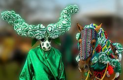 Mascarados, personagens vestem-se com mascaras e saem as ruas, a cavalo ou a pe, fazendo algazarras durante as Cavalhadas, manifestacao folcorica que acontece apos os festejos da Festa do Divino Espirito Santo.Sua origem esta lidado a Portugal, sendo uma manifestacao religiosa e de alegria. Era uma maneira de espantar o espirito do mal. / Masked, countless characters dress in masks and take to the streets on horseback or on foot, causing uproar in the Cavalhadas, a manifestation of folk dramatic happens after the celebration of the Feast of the Holy Spirit.