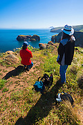 Hikers whale watching at Scorpion Cove, Santa Cruz Island, Channel Islands National Park, California USA