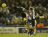 Photo: Aidan Ellis.<br /> Sheffield Wednesday v Birmingham City. Coca Cola Championship. 16/12/2006.Birmingham defender Radhi jaidi beats Sheffield's Chris Adamson to win the header