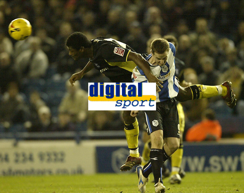 Photo: Aidan Ellis.<br /> Sheffield Wednesday v Birmingham City. Coca Cola Championship. 16/12/2006.Birmingham defender Radhi jaidi beats Sheffield's Chris Adamson to win the header