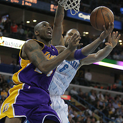 12 November 2008: Los Angeles Lakers guard Kobe Bryant (24) shoots between Hornets defender Tyson Chandler (6) during a NBA regular season game between the Los Angeles Lakers and the New Orleans Hornets at at the New Orleans Arena in New Orleans, LA..