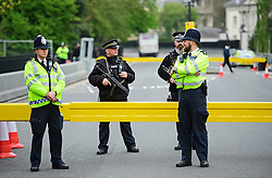 © London News Pictures. 22/04/2016. London, UK. Armed police stand on guard at the entrance to the ambassadors residence. Heightened security surrounding the residence of the US Ambassador to the United Kingdom in Regents Park, London, where the President of the United States Barak Obama is staying during his visit to the UK. Photo credit: Ben Cawthra/LNP