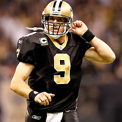 November 21, 2010; New Orleans, LA, USA; New Orleans Saints quarterback Drew Brees (9) reacts after throwing a touchdown pass during the second quarter against the Seattle Seahawks at the Louisiana Superdome. Mandatory Credit: Derick E. Hingle