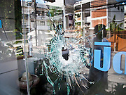 21 MAY 2010 - BANGKOK, THAILAND: A window of a dentist's practice shot out by unidentified snipers in Bangkok during anti government violence Wednesday. Clean up continued in Bangkok Friday, two days after the army cleared the streets of anti government protesters.  PHOTO BY JACK KURTZ