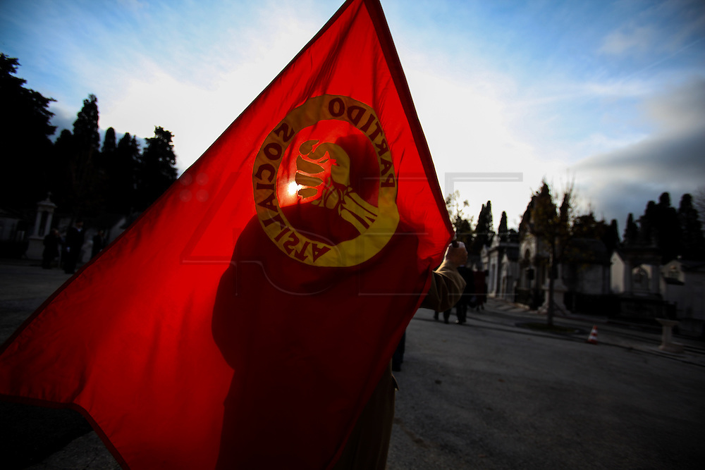 January 6, 2017. Lisbon - Portugal.<br /> Man with a Socialist Party flag.<br /> Funeral ceremony of Mario Soares. Ex-president of the republic of Portugal.