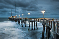 The blue hour of a stormy morning stands over Jennette's Fishing Pier in Nags Head, North Carolina.  I thought this morning was going to be a complete loss with a storm forecast to arrive shortly hereafter; however, the deep hues were very neat when used with the lit pier.