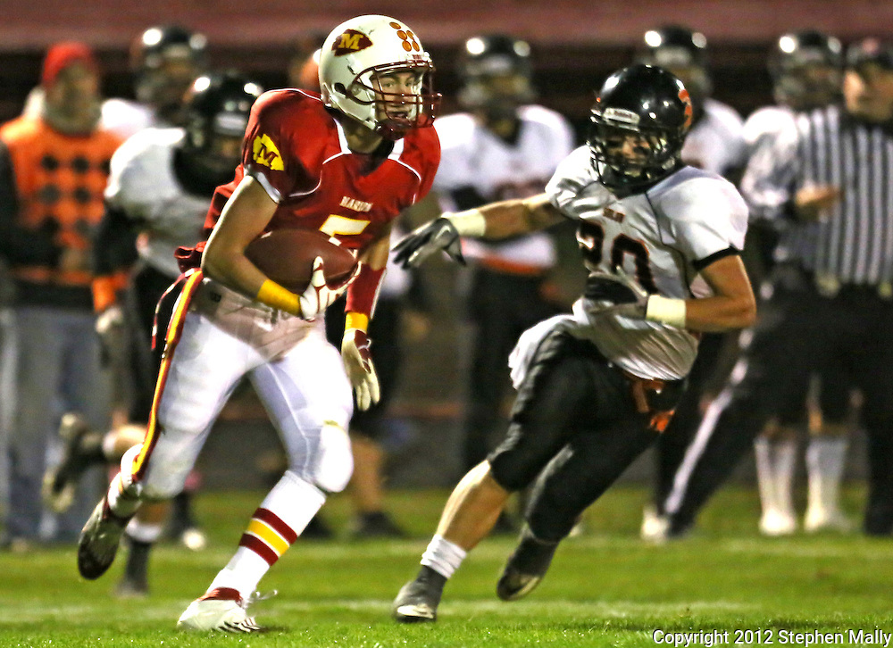 Marion's Tyler Gunderson (5) runs after an interception as Solon's Austin Holub (20) gives chase during the first half of the game between the Solon Spartans and the Marion Indians at Thomas Park Field in Marion on Friday evening, October 5, 2012.