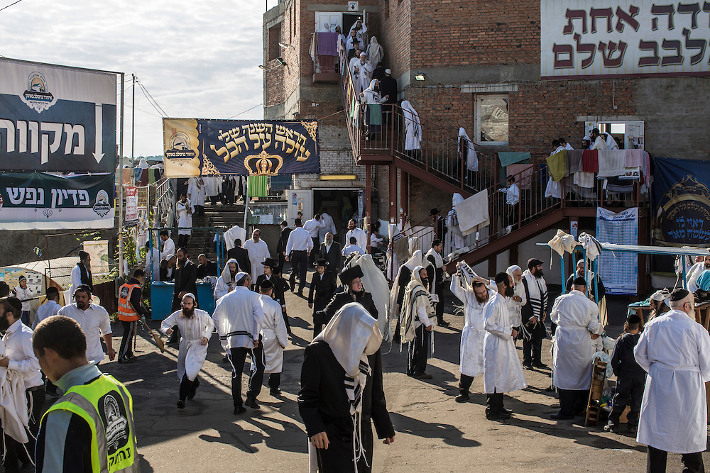 UMAN, UKRAINE - SEPTEMBER 14: Hasidic pilgrims pray near the burial site of Rebbe Nachman of Breslov on September 14, 2015 in Uman, Ukraine. Every year, tens of thousands of Hasidim gather for Rosh Hashanah in the city to pray at the holy site. (Photo by Brendan Hoffman/Getty Images) *** Local Caption ***