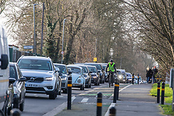 © Licensed to London News Pictures. 10/02/2020. London, UK. Heavy traffic on Priory road near Richmond Park. The A205 Upper Richmond Road South Circular has suffered delays as Richmond Park remains closed Monday in the aftermath of Storm Ciara as safety checks and clearance continues…. Photo credit: Alex Lentati/LNP