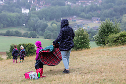 © Licensed to London News Pictures. 08/07/2020. Surrey, UK. Picnickers brave the midsummer rain on Box Hill in the Surrey Hills as weather forecasters predict a mild but wet couple of days ahead followed by sunnier and warmer weather for the weekend. Photo credit: Alex Lentati/LNP