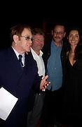 Sir Elton John, Alain-Dominique Perrin, Jean Reno and Zofia Borucka. 4 Inches, A  Photographic Auction in aid of the Elton John Aids Foundation hosted by Tamara Mellon and Arnaud Bamberger. Christie's. 8 King St. London. 25 May 2005. ONE TIME USE ONLY - DO NOT ARCHIVE  © Copyright Photograph by Dafydd Jones 66 Stockwell Park Rd. London SW9 0DA Tel 020 7733 0108 www.dafjones.com