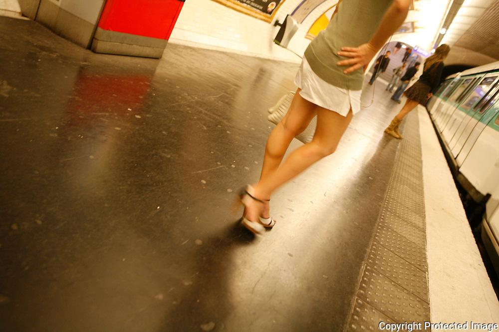 women waiting for the metro in Paris
