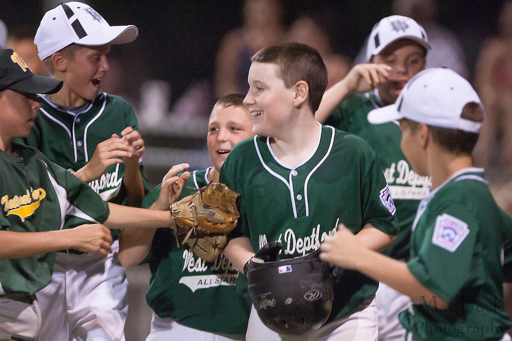 West Deptford's Mike Flaherty is greeted by teammates after hitting a two run homerun in the 5th inning during a District 15 Little League 11 year old all-star game against National Park held in Deptford Friday July 22, 2011.