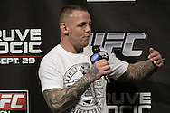"NOTTINGHAM, ENGLAND, SEPTEMBER 28, 2012: Ross Pearson answers questions from fans ahead of the official weigh-in for ""UFC on Fuel TV 5: Struve vs. Miocic"" inside the Capital FM Arena in Newcastle, United Kingdom on Friday, September 28, 2012 © Martin McNeil"
