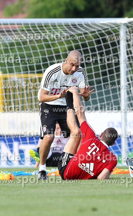 04.07.2013, Campo via Pomerio, Arco, ITA, FC Bayern Muenchen Trainingslager, im Bild Pep GUARDIOLA (FC Bayern Muenchen) spricht mit Franck RIBERY (FC Bayern Muenchen), // during the Trainings Camp of German Bundesliga Club FC Bayern Munich at the Campo via Pomerio, Arco, Italy on 2013/07/04. EXPA Pictures &copy; 2013, PhotoCredit: EXPA/ Eibner/ Alexander Neis<br /> <br /> ***** ATTENTION - OUT OF GER *****