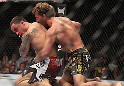 October 8, 2011; Houston, TX.; USA;  UFC Lightweight Champion Frankie Edgar (red trunks) and challenger Gray Maynard (gray trunks) during their fight at UFC 136 at the Toyota Center in Houston, TX.
