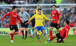 Arsenal's Mesut Ozil is tackled by Cardiff City's Gary Medel - Photo mandatory by-line: Gary Day/JMP - Tel: Mobile: 07966 386802 30/11/2013 - SPORT - Football - Cardiff - Cardiff City Stadium - Cardiff City v Arsenal - Barclays Premier League
