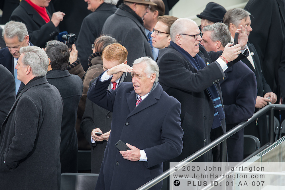 Rep. Steny Hoyer with his iPhone looking out at the crowd at the 57th Presidential Inauguration of President Barack Obama at the U.S. Capitol Building in Washington, DC January 21, 2013.