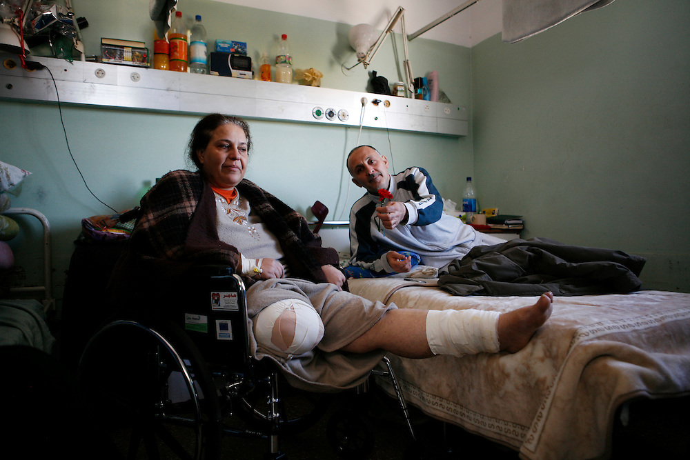 Abdel Naser Zemo sits with his wife, Suheir, in her room a the al-Shifa hospital in Gaza City. Suheir's leg was blown off by a rocket fired from an Israeli apache helicopter while the couple sat in their family's home during Israel's three weeks of attacks on Gaza.