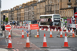 Edinburgh, Scotland, UK. 22 June, 2020. Traffic management work and lane closures on Leith Walk signals the start of construction work for the new Edinburgh tram line extension to Newhaven. Disruption to traffic and businesses on Leith Walk is expected to last for over a year. Iain Masterton/Alamy Live News