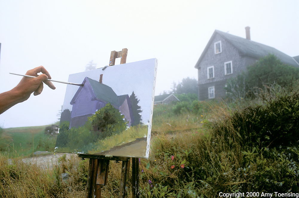 MONHEGAN ISLAND, MAINE - JULY 18: Painter Kevin Beers depicts an island house on his canvas, July 18, 2000 on Monhegan Island, Maine. Monhegan Island, home to lobstermen and painters and a popular destination for tourists is twelve miles off the coast of Maine. Ringed by high, dark cliffs, its interior a mix of meadows, marsh and spruce groves, Monhegan is one of just 14 true island communities left off the coast of Maine. The island has a 65 permanent, year-round residents and the population grows to around 200 in the summer, with day-trippers adding several hundred more. (Photo by Amy Toensing) _________________________________________<br />