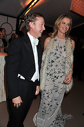 GEORDIE GRIEG and EVA HERZIGOVA at the Raisa Gorbachev Foundation Gala held at the Stud House, Hampton Court, Surrey on 22nd September 22 2011