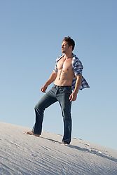 All American man with an open shirt outdoors in the desert