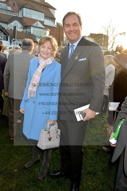 LADY LLOYD-WEBBER and the HON.HARRY HERBERT at the 2014 Hennessy Gold Cup at Newbury Racecourse, Newbury, Berkshire on 29th November 2014.  The Gold Cup was won by Many Clouds ridden by Leighton Aspell.